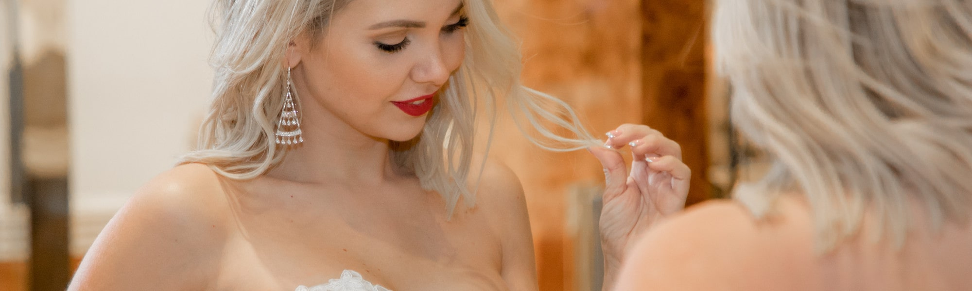blonde bride in front of mirror at las vegas wedding chapel